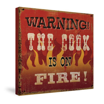 The Cook is On Fire Canvas Wall Art