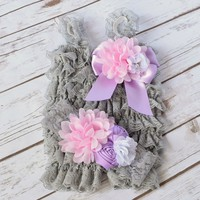 Your Final Touch - ruffled lace grey romper and headband is embellished with a 5 inch lavender satin bow, 4 1/2 pink chiffon flower, lavender rolled rosettes and white flower with pearls and rhinestones