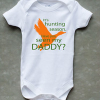 It's Hunting Season.  Have You Seen My DADDY? Baby Onesuit or Kid's T-Shirt for girls in pink and green, and boys in orange and green.
