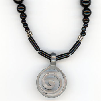 Spiral Swirling Pendant Glides on Shiny Black Bead by Lehane