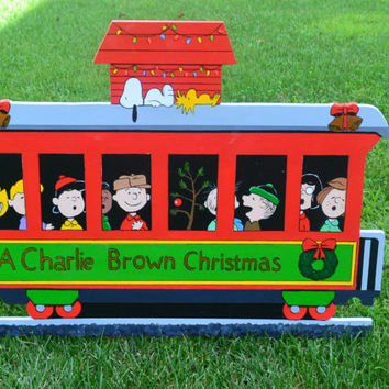Charlie Brown Christmas train with Snoopy, Woodstock and all Peanuts gang lawn stake yard art