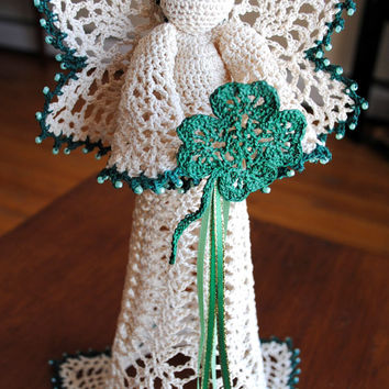 St. Patricks Day crochet angel holding a clover with ribbon, ecru with green trim and beads, gold halo