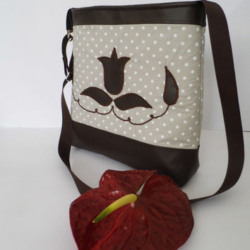 Polka dotted cotton and textile leather purse with appliqued flower pattern