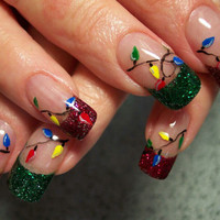 http://www.fashionfame.com/wp-content/uploads/2010/10/2010-christmas-nail-art-trend.jpg