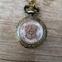 Semester at Hogwarts...Antique gold Hogwart's crest.... emblem pocket watch necklace...Harry Potter