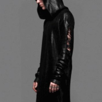 This soft unisex style black ink foil tattered knit hoodie dress, features distressed detailing throughout, a hooded neckline, long sleeves with thumbholes, and finish with shiny tattered on outside of knit dress. Pair with cami, leggings ankle zipper & la