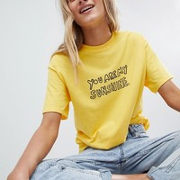 Daisy Street Boyfriend T-Shirt With Sunshine Print at asos.com
