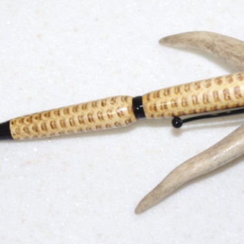 Corncob pen! This is an actual corncob that has been stabilized. Black  Metal components. A great combination! 30 Bolt Action Pen
