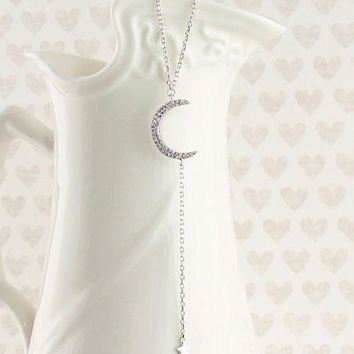Dainty Crescent Moon with Dangling Star Necklace in Sterling Silver