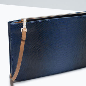 Two-tone clutch with metallic detail