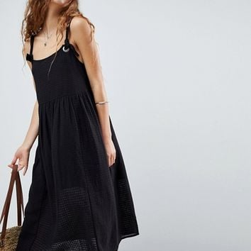 ASOS DESIGN Casual smock midi sundress in grid texture with knot tie at asos.com