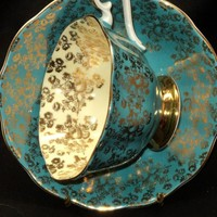 Royal Albert TURQUOISE GOLD CHINTZ Tea cup and saucer