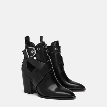 HEELED ANKLE BOOTS WITH CUT OUTS