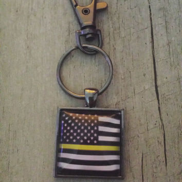 dispatcher thin yellow/gold line american flag keychain