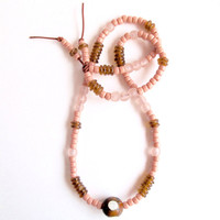 Long beaded necklace with peach, amber colors and light pink glass beads on copper colored leather cord Fall fashion An Astrid Endeavor