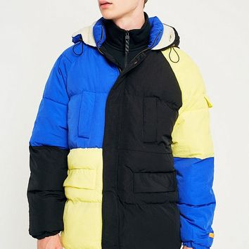 The New County Blue Yellow and Black Oversized Puffer Jacket | Urban Outfitters