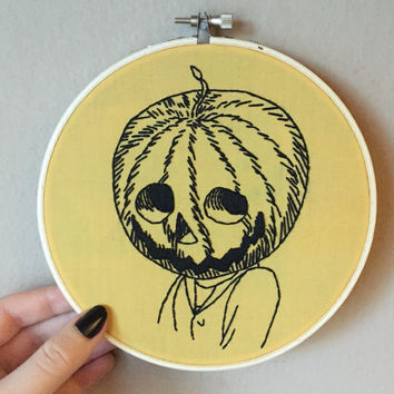 Pumpkin man hand embroidery on mustard yellow fabric set in a 6 inch hoop, halloween wall art, jack o lantern embroidered hoop art