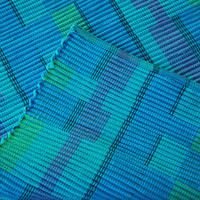 23 x 36 inch Handwoven rag rug in bright turquoise, purple and royal blue.