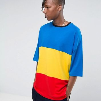 ASOS Super Oversized T-Shirt With Cut And Sew Panels and Contrast Ringer at asos.com