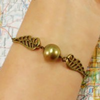 Golden ball snitch Harry Potter charm bracelet