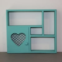 Small teal painted wood knick knack display