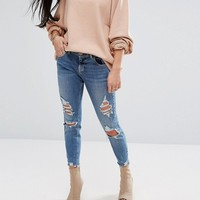 River Island Petite Skinny Jeans With Rips at asos.com