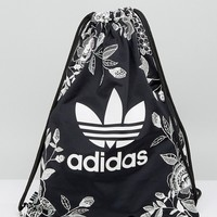 adidas Originals Farm Print Drawstring Backpack In Monochrome Floral at asos.com