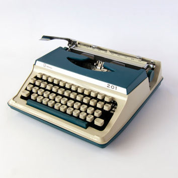 Blue Portable Typewriter- Imperial Litton 201. In Good Working Condition. Carry Case Included. Made in Japan.