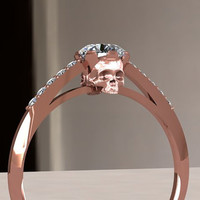 Rose gold skull engagement ring