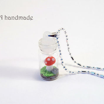 Tiny mushroom in a bottle necklace