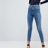 ASOS RIDLEY High Waist Skinny Jeans With Seamed Split Front in Noelle Light Wash at asos.com