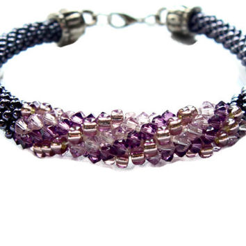 Bead crochet spiral bracelet with Swarovski elements. Dark and light amethyst