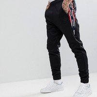 Reebok Retro Joggers In Black BQ5422 at asos.com