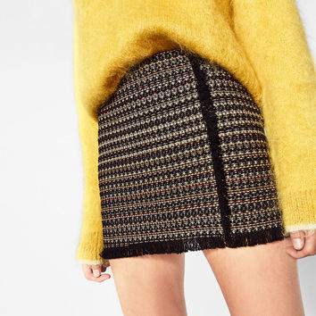 FRINGED MINI SKIRT DETAILS