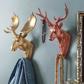 The head of the animal creative decorative hook resin crafts individual deer head wall hanging hooks behind the door  mural.