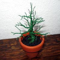 Rugged little evergreen tree in terra-cotta pot - a twisted wire tree sculpture