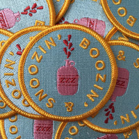 """Boozin' & Snoozin' 2.5"""" funny iron-on embroidered patch"""