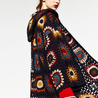 LIMITED EDITION CROCHET COAT WITH HOODDETAILS