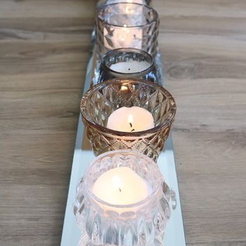 "Set of 7 Assorted Amber Glass Candle Holders on Mirrored Base - 20"" Long"