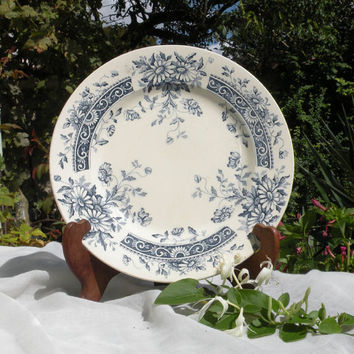 An ironstone cake plate with blue transferware illustrated with daisies French ironstone blue transferware French vintage cake plate