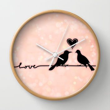 Birds on a wire Love bokeh with heart pink and black lovebirds Wall Clock by Jaclyn Rose Design