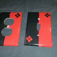 Red and black Harley Quinn handpainted light switch and plug covers