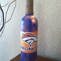 Denver Broncos Wine Bottle Light painted blue with white lights.