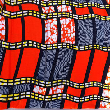 African Wax Print Fabric by the HALF YARD.  Wavy Stripes in orange, navy blue, and yellow