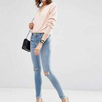 ASOS Lisbon Mid Rise Skinny Jeans In Shelby Light Stonewash with Shredded Knees and Chewed Hems at asos.com