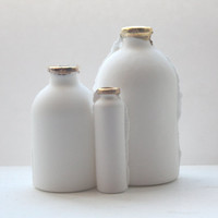 Trio of English fine bone china bottles with gold rims
