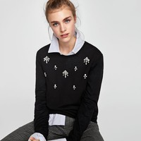 SWEATER WITH BEJEWELLED APPLIQUÉS DETAILS