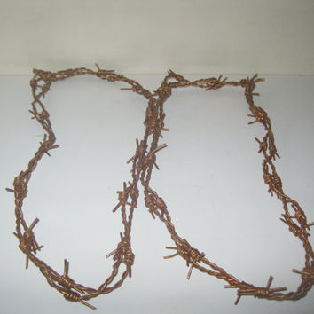 2 Leather barbed wire necklaces......Gold color and about 18 inches long......bracelet.....hat band...