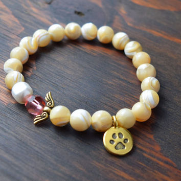 Natural Mother of Pearl Bracelet. Paw Print Bracelet. Angel Wing Bracelet. Pet Memorial Bracelet. Pearl Bracelet. Lotus and Lava Bracelet.