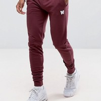 Good For Nothing Skinny Joggers In Burgundy with Small Logo at asos.com